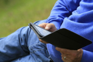Man-Reading-Kindle-by-Tina-