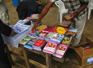Customers browse the book table in front of a church in Jos, Nigeria.