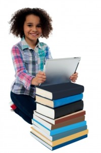 Smiling girl with books and tablet Freedigitalphotos