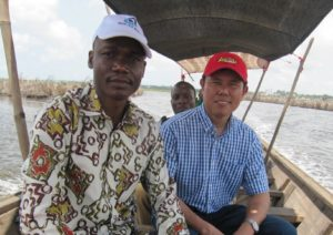 Enjoying a boat ride with Georges Late, manager of Editions PBA, in Benin.